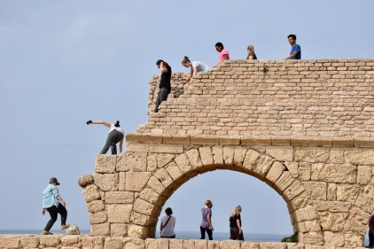 JUC students climbing down from Herod's Aquaduct.